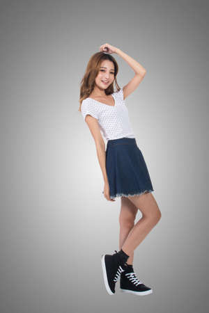 asia people: Young Asian girl, full length portrait isolated. Stock Photo