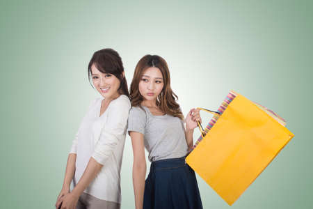buyer: Asian shopping woman with her friends holding bags.