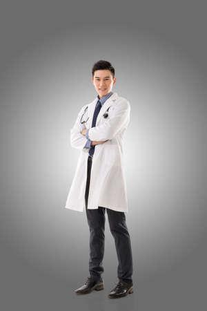 Asian doctor man, full length portrait isolated.