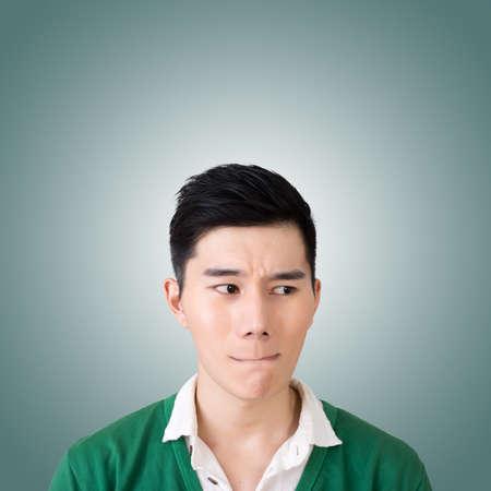 facial expression: Funny facial expression, closeup Asian young man. Stock Photo