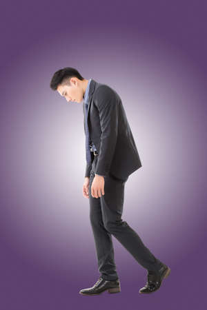 man sad: Regret young business man standing and thinking, full length portrait isolated Stock Photo