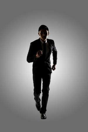 businessman running: Confident businessman running, silhouette portrait isolated