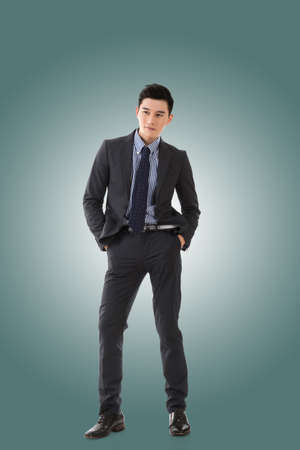 young businessman: Attractive young Asian businessman, full length portrait isolated