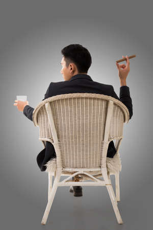 cunning: Cunning businessman of Asian sit on chair.
