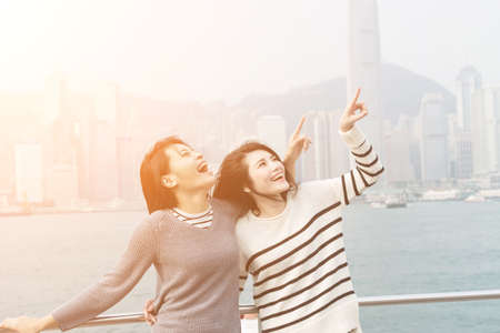 asia people: Asian happy young girls traveling at Victoria harbor, Hong Kong, Asia. Stock Photo