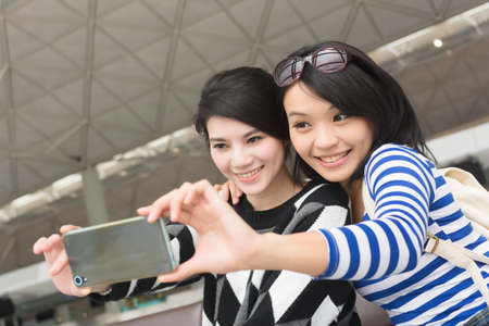 young friends: Asian woman with her friend traveling abroad