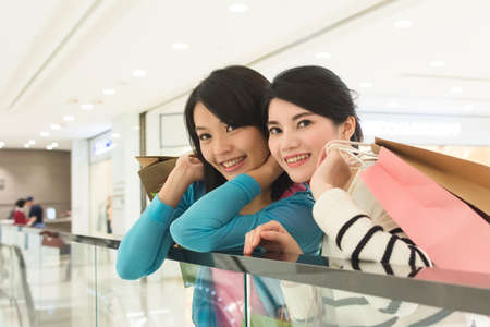 excite: Excite woman go shopping with her friend in department store
