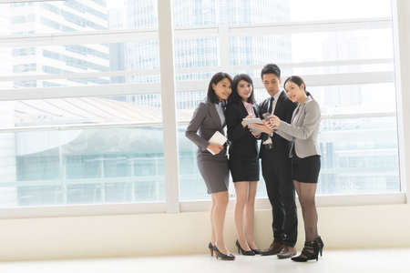 copyspace: Group of business people work together with pad Stock Photo