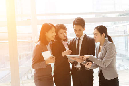 building planners: Group of business people work together with pad Stock Photo