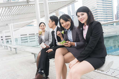 asian businesswoman: group of Asian business team having lunch in the outdoor