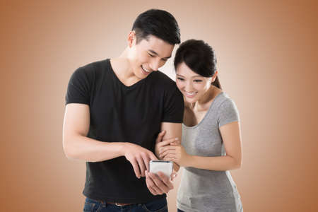 asian guy: Asian young couple using cellphone, closeup portrait. Stock Photo