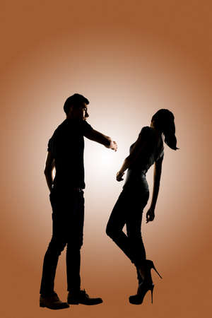 animosity: Silhouette of a man slapping a woman depicting domestic violence, full length isolated.