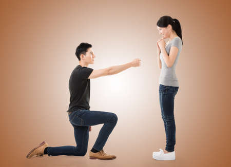 propose: young Asian man propose to his girlfriend, studio shot