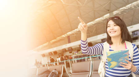 Asian young woman in the airport wait the aircraft