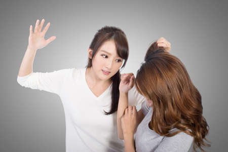 Asian women fight and pull hair. Stock Photo