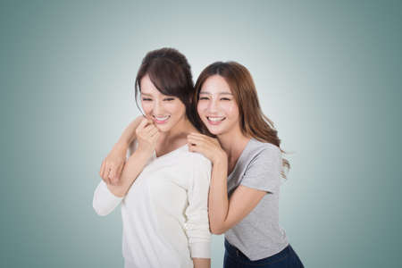 asian lady: Asian woman with her friend, studio shot portrait.