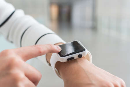 wearable: Woman using Smartwatch pay by NFC