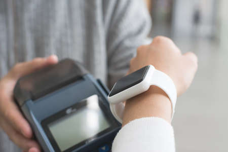 nfc: Woman using Smartwatch pay by NFC