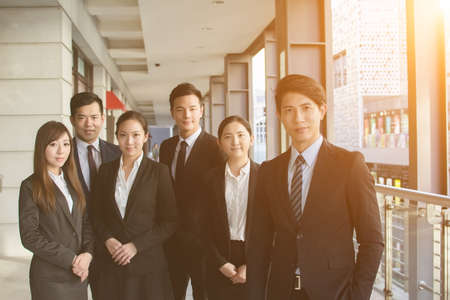 team leadership: Successful business team of Asian in the city. Stock Photo