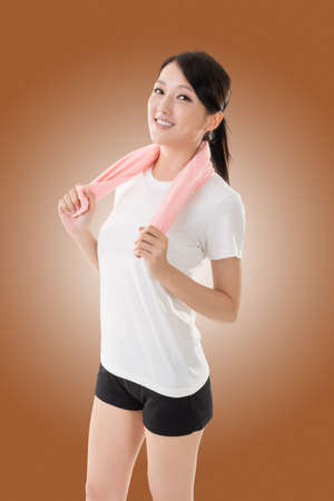 head rest: Smiling sporty asian woman take a rest after training. Closeup portrait Stock Photo