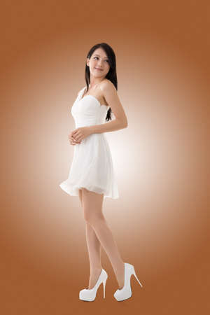 chinese dress: Smiling Asian young woman, full length portrait isolated.