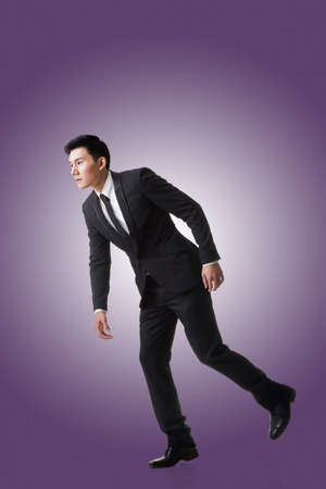puppeteer: Marionette pose, asian business man isolated Stock Photo