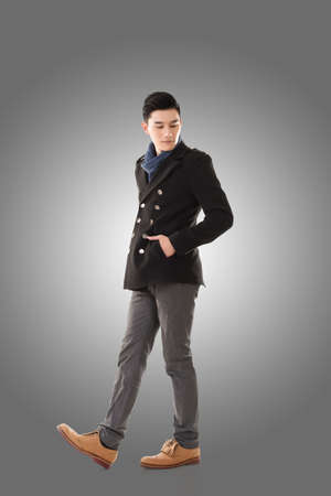 cool man: Asian young man feel cold in the winter, full length portrait isolated