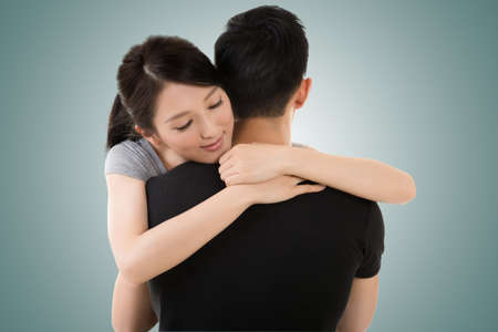 hugs: Asian young couple hug and comfort, closeup portrait