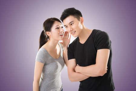 whisper: young Asian couple whisper, closeup portrait. Stock Photo