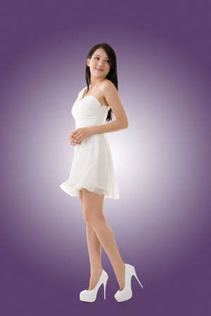 young asian: Smiling Asian young woman, full length portrait isolated.