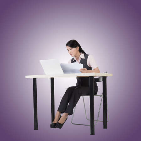 businesswoman suit: Asian business woman sit and work, full length portrait.