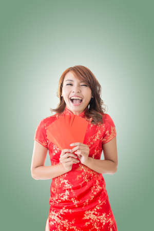 cheongsam: Attractive Chinese woman dress traditional cheongsam and hold red envelope Stock Photo