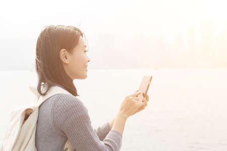 asia people: Woman use of mobile phone at outdoor Stock Photo