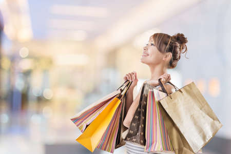 asian lifestyle: Shopping girl of Asian, closeup portrait isolated on white with clipping path. Stock Photo