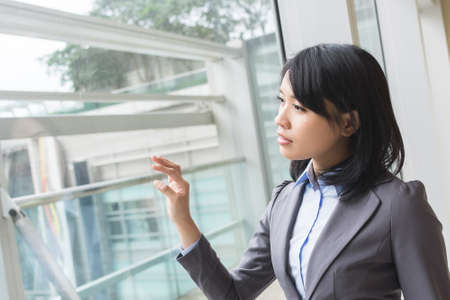copyspace: Asian business woman touch the screen or the glass