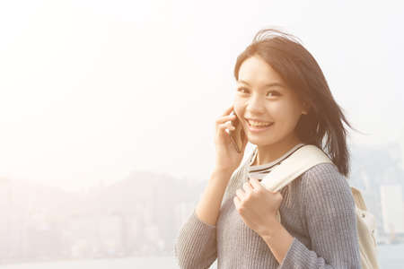 japanese people: Asian woman talk to cellphone