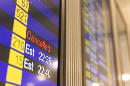 cancel: info of flight on billboard in airport Editorial