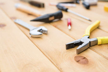hardware tools: tools on the wooden background