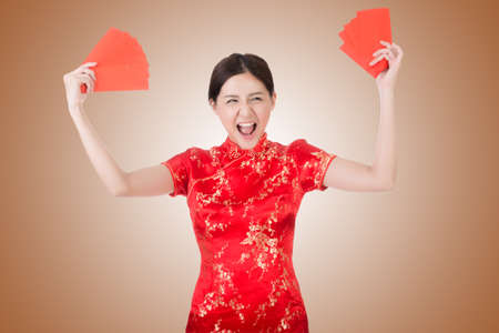chipao: Chinese woman in traditional cheongsam in the new year