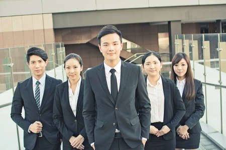 asian business team: Successful business team of Asian in the city. Stock Photo