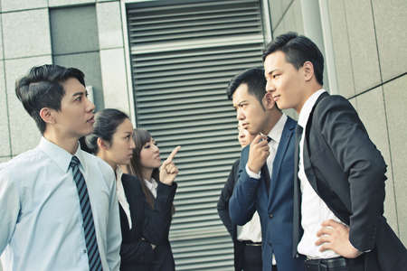 Office women: concept of office bully or fight with man and woman in the city Stock Photo