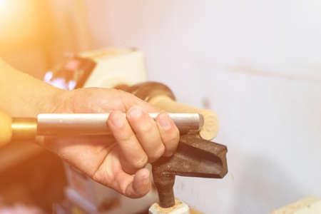 wood turning: worker turning wood on a lathe Stock Photo
