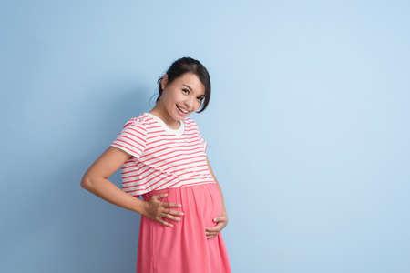 young asian pregnant woman, closeup portrait with copyspace