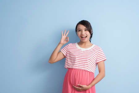 young asian pregnant woman, closeup portrait with copyspace