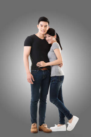 Attractive young Asian couple, full length portrait isolated. photo