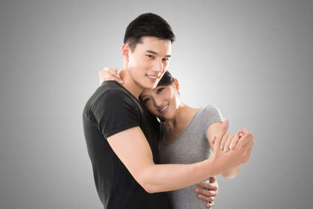 young Asian couple dancing with smiling face. photo