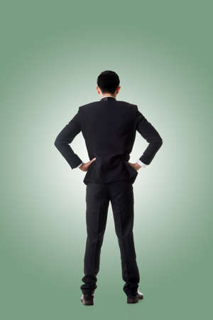 persona pensando: Confused young business man standing and thinking, full length portrait isolated
