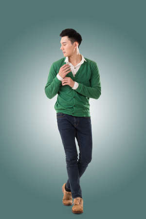 isolated man: Handsome young Asian man with sweater, full length portrait isolated.