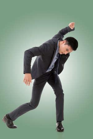 struggle: Struggle pose of Asian business man, full length isolated.
