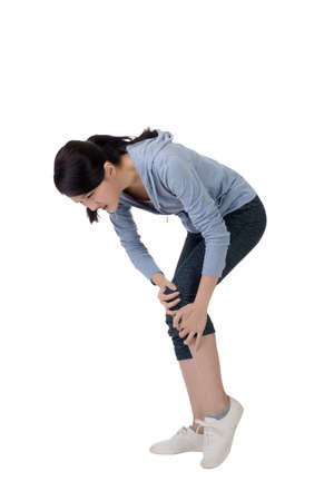 ailing: young asian woman with knee pain Stock Photo